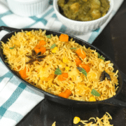A bowl of food on a plate, with Biryani and Rice