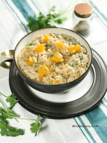 A bowl of squash risotto on the flat surface