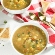 A bowl of soup on a table, with Chowder and Potato