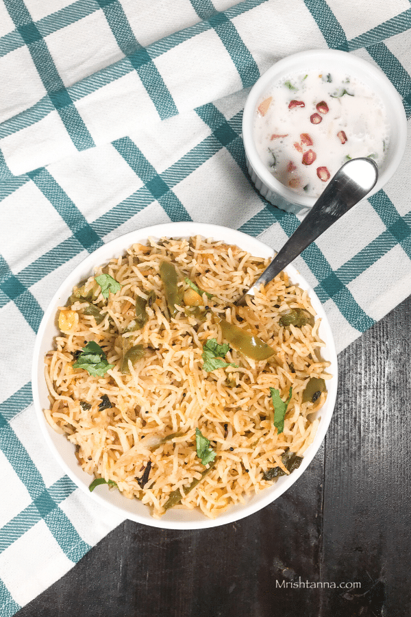 A plate of capsicum rice with a fork