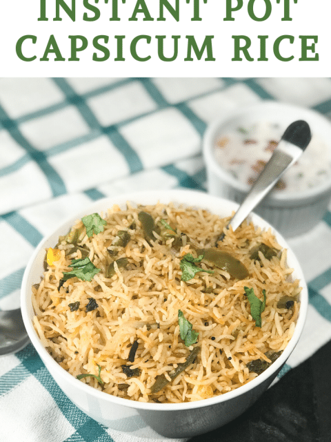 A bowl of rice on the table topped with cilantro