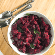 A bowl of food on a plate, with Beetroot