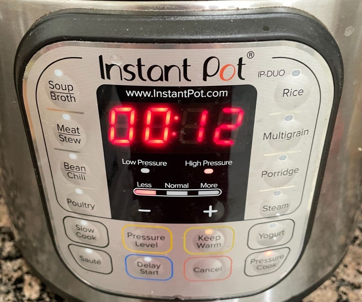 An Instant pot showing cooking mode with number on it
