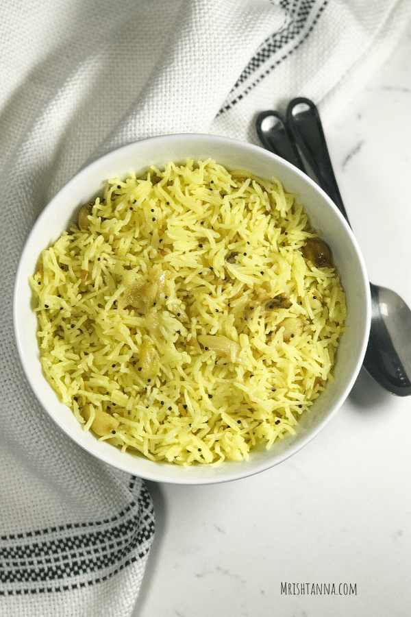 A bowl of food, with Rice and Garlic
