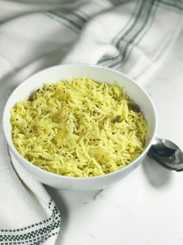 A bowl of food, with garlic rice