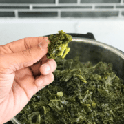 A man showing steamed Kale