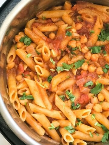 An instant pot is with tikka masala pasta on the surface