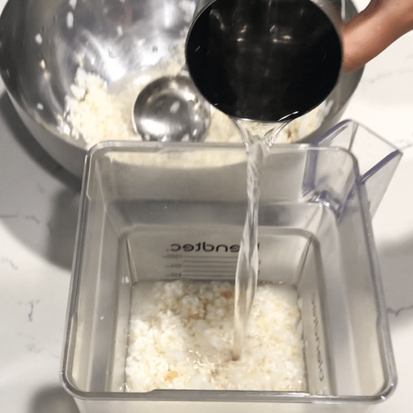 Blender filled with rice and water