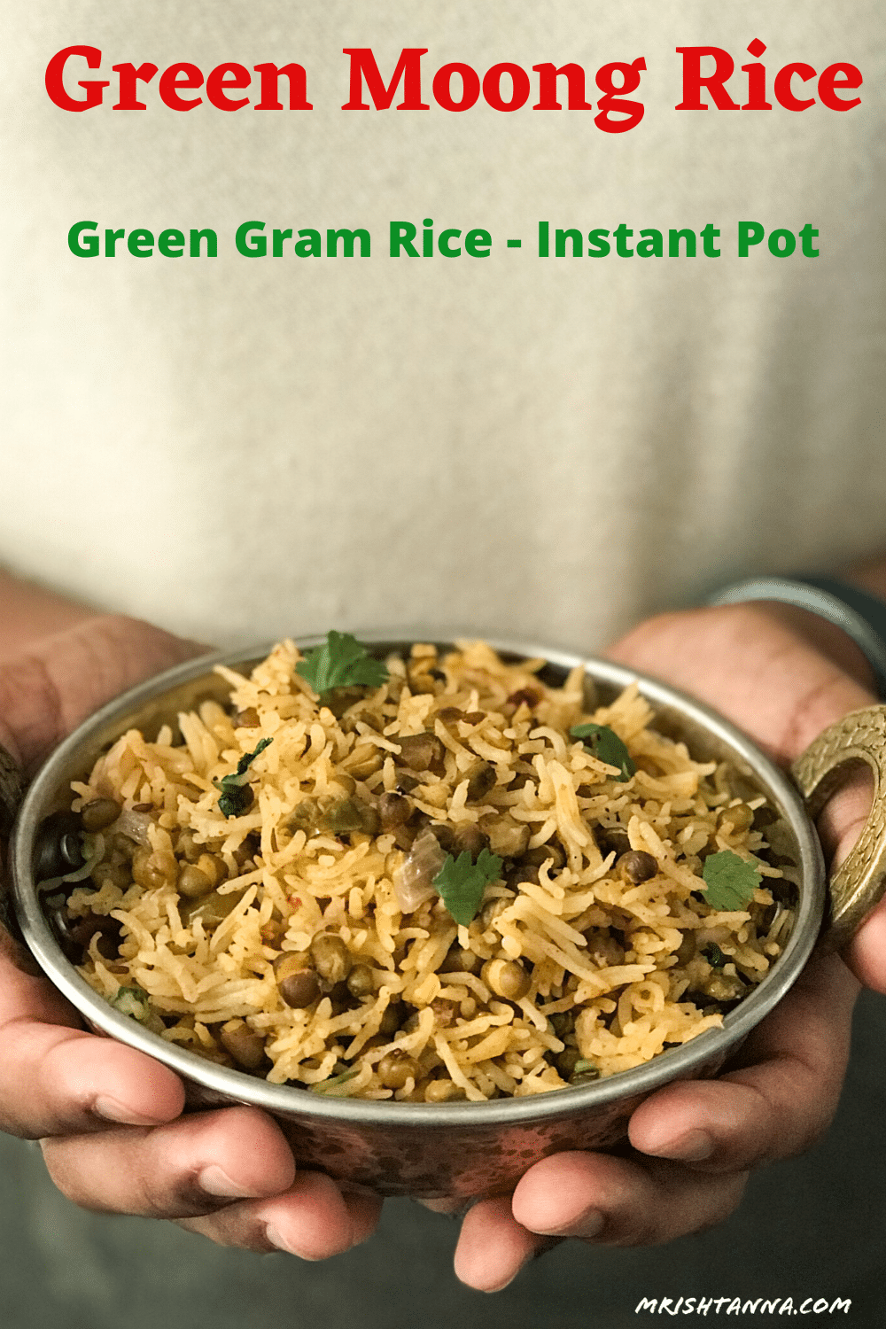 A person holding a bowl of green gram rice