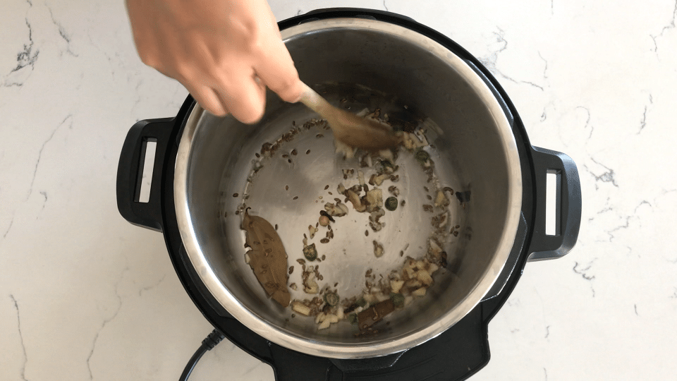 An instant pot with spices