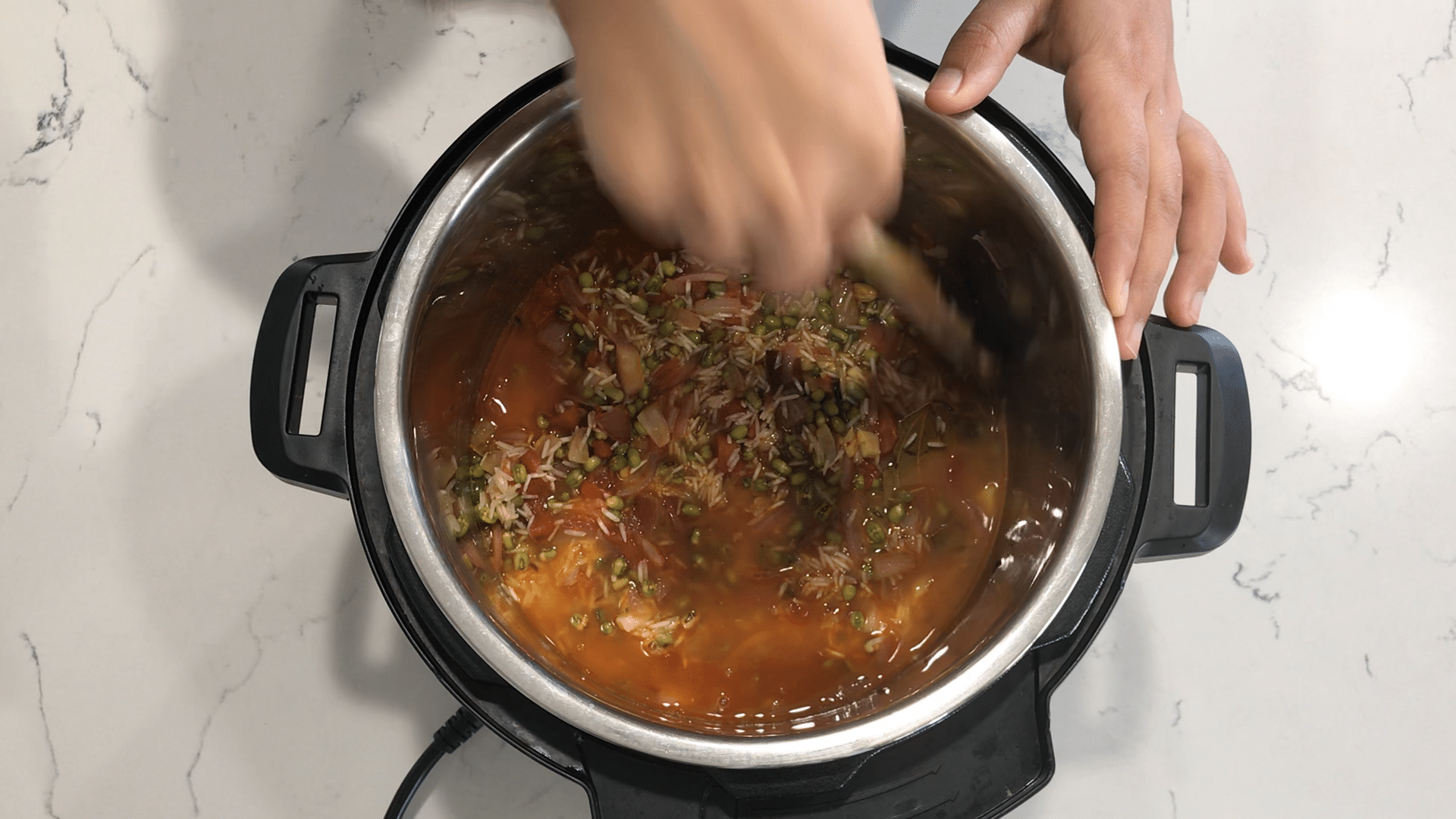 Instant Pot filled with spices, rice, and with dal