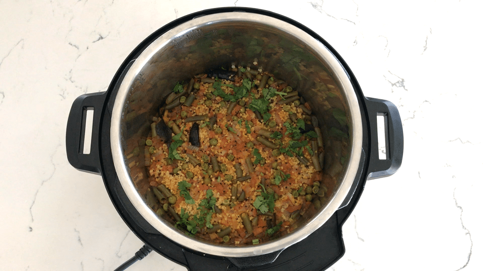 A bowl of food, with millet and Curry