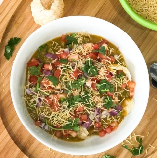 A bowl of food on a plate, with Chaat and Masala puri
