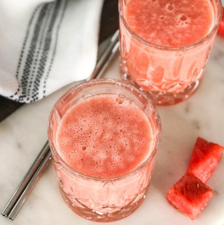 A glass Smoothie and watermelon