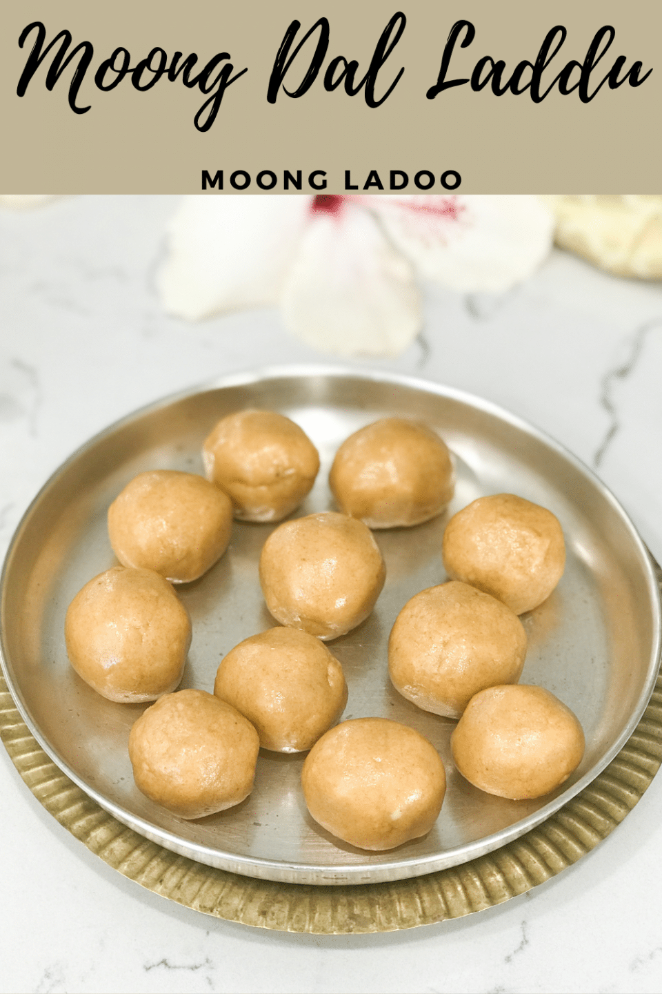 A silver plate filled with Moong laddu