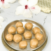 Moong laddus are placed in a sliver plate