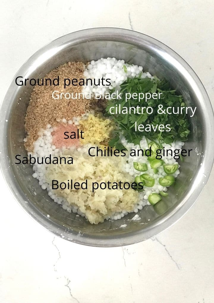 Sabudana, potatoes and other ingredients are placed in a big bowl