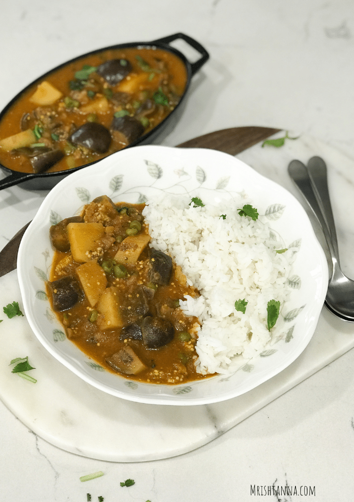 White rice and curry in a white plate