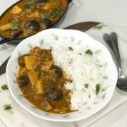 A black pot is filled with curry