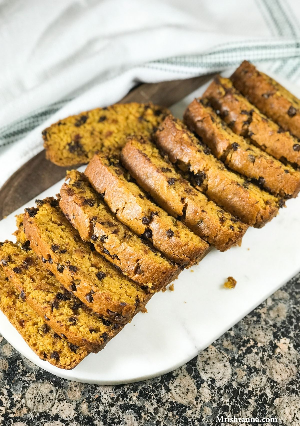 Vegan Pumpkin bread is sliced and placed on the white surface