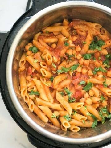 An instant Pot filled with masala pasta and chickpeas