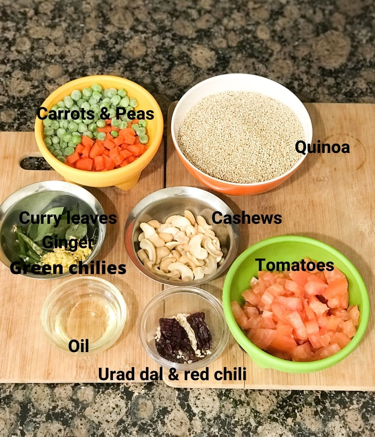 All the ingredients are placed on the counter for quinoa upma including quinoa, vegetables, tomatoes etc