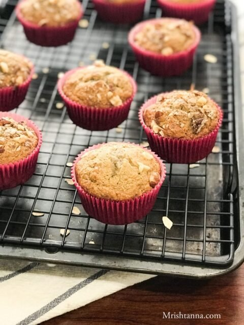 Banana oat muffins are placed on the cooling wire rack