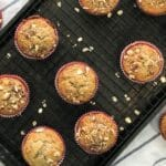 Banana oat muffins are placed on the cooling wire racks