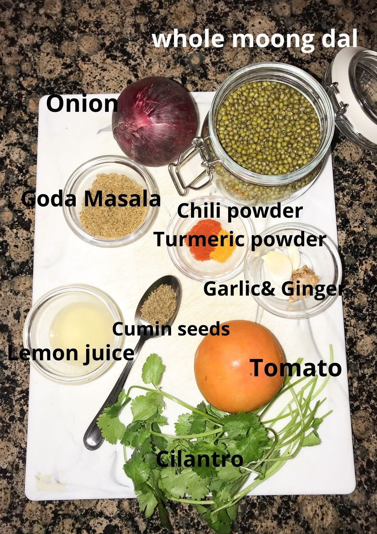 ingredients are placed on the counter tops like green gram, onions, tomatoes