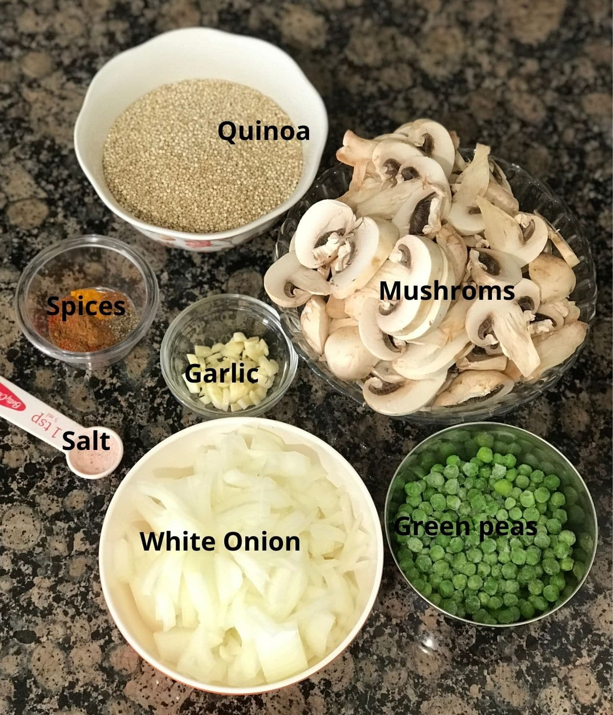 All the ingredients like onions, mushrooms, spices are placed on the counter tops