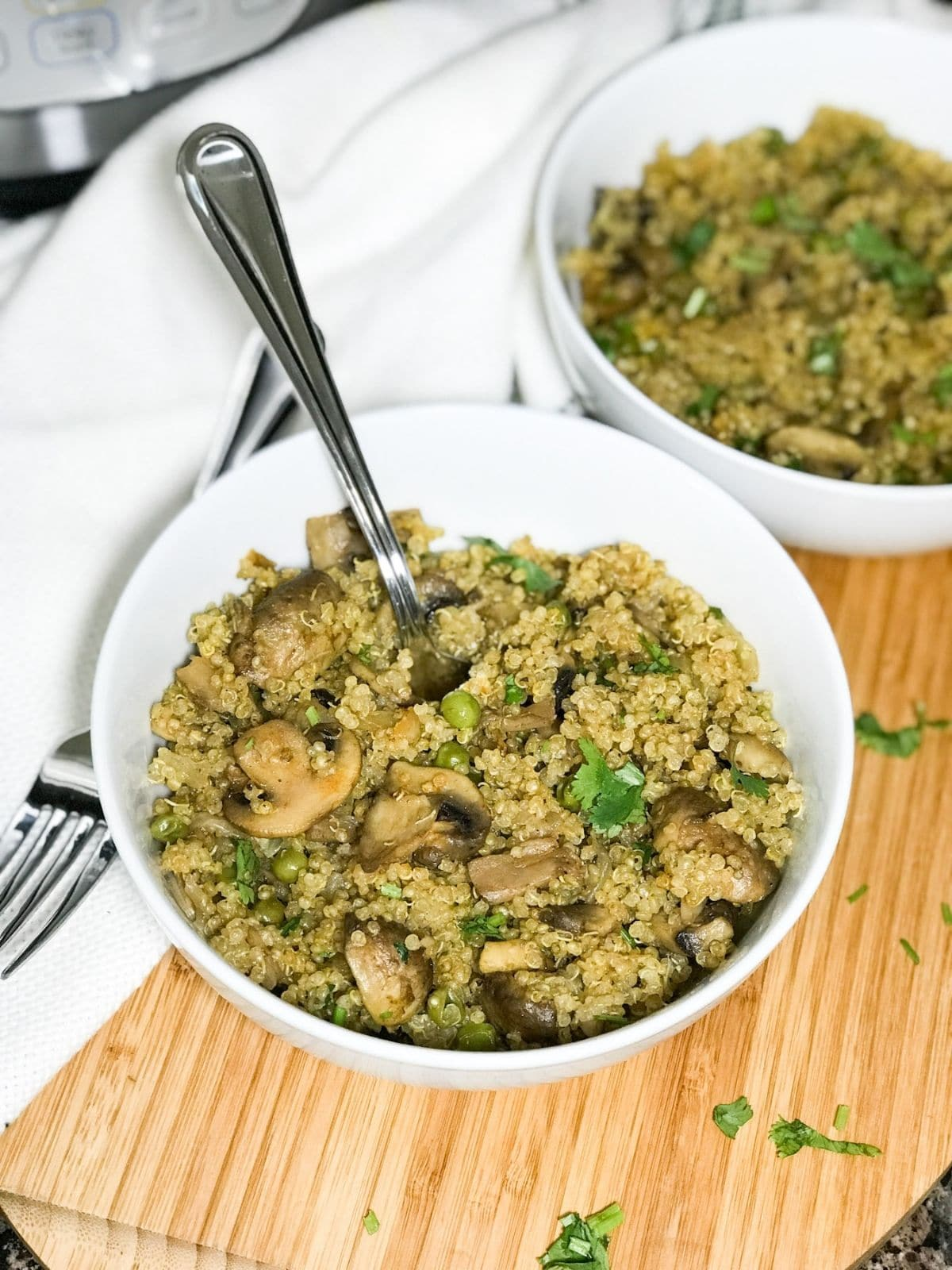 A bowl with mushroom quinoa is on the table
