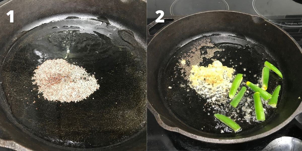 A cast iron pan is on the stove top filled with oil and mustard seeds