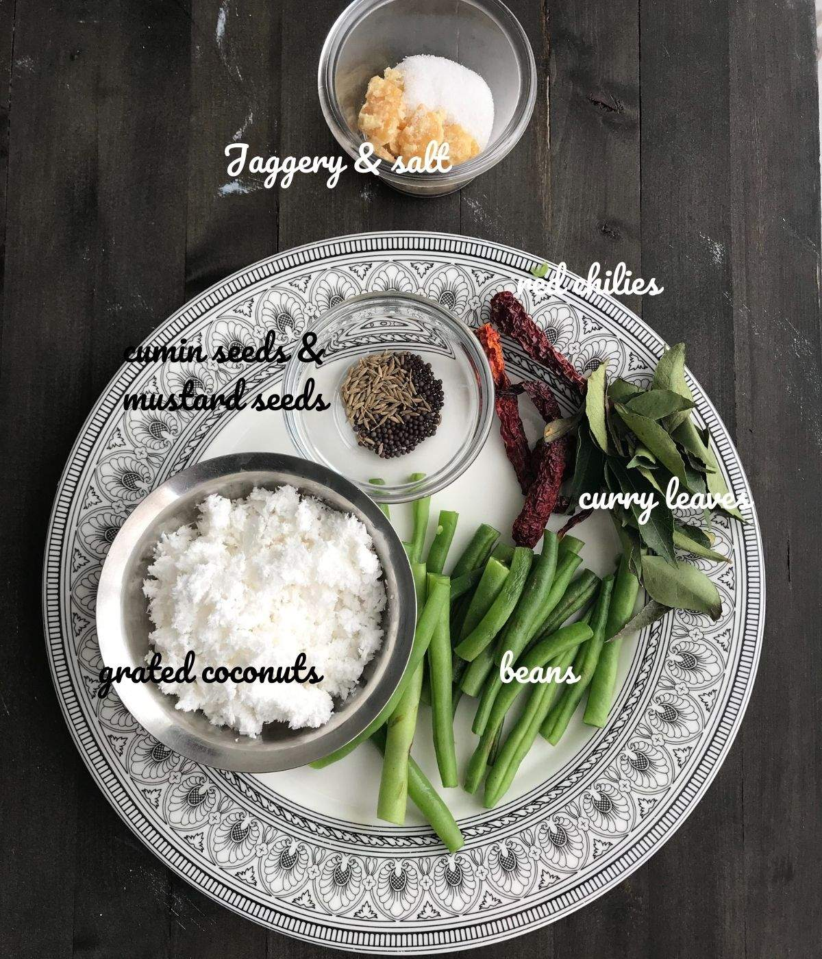 A plate is with beans stir fry ingredients like coconuts, spices and chili