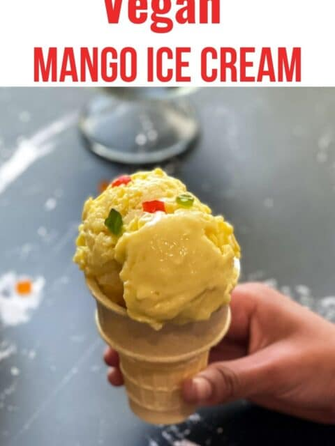 A cone is filled with mango ice cream