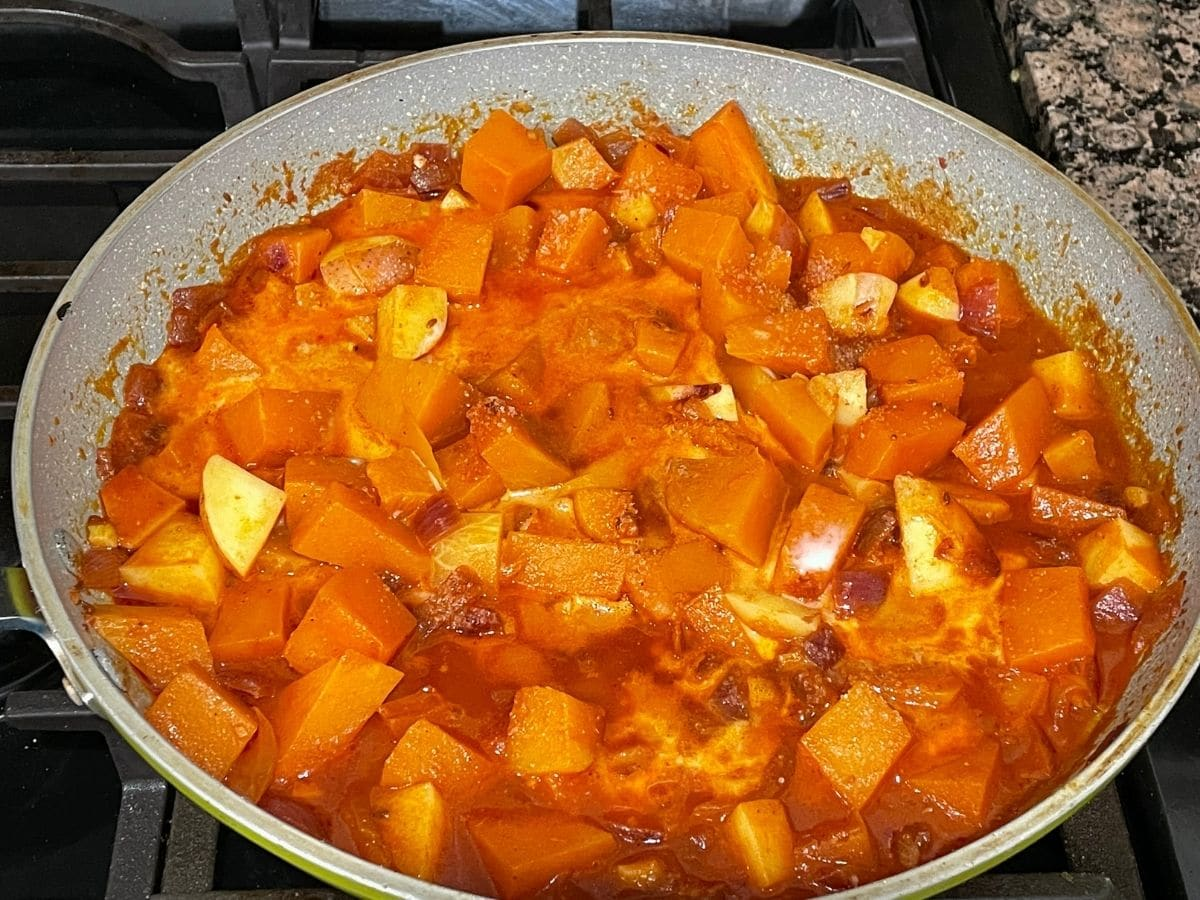 Pumkin curry is with coconut milk and cooking over the medium heat