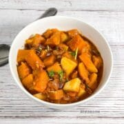 A close up of bowl with Indian pumpkin curry