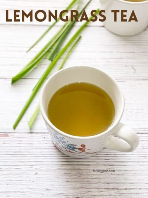 A cup of lemongrass tea is on the surface.