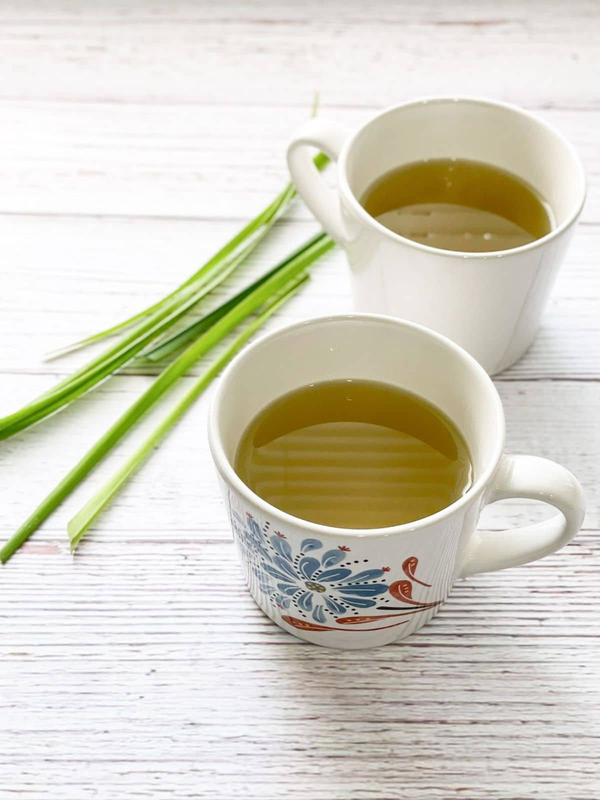 Two cups of lemongrass tea is on the table.