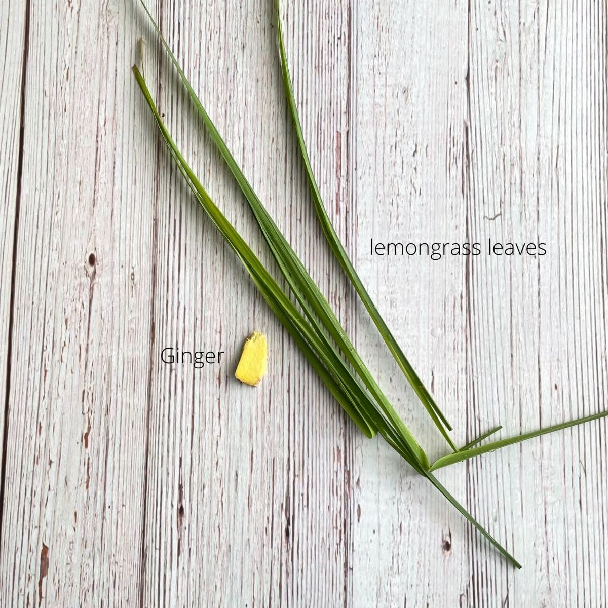 lemongrass leaves, and ginger root is on the table.